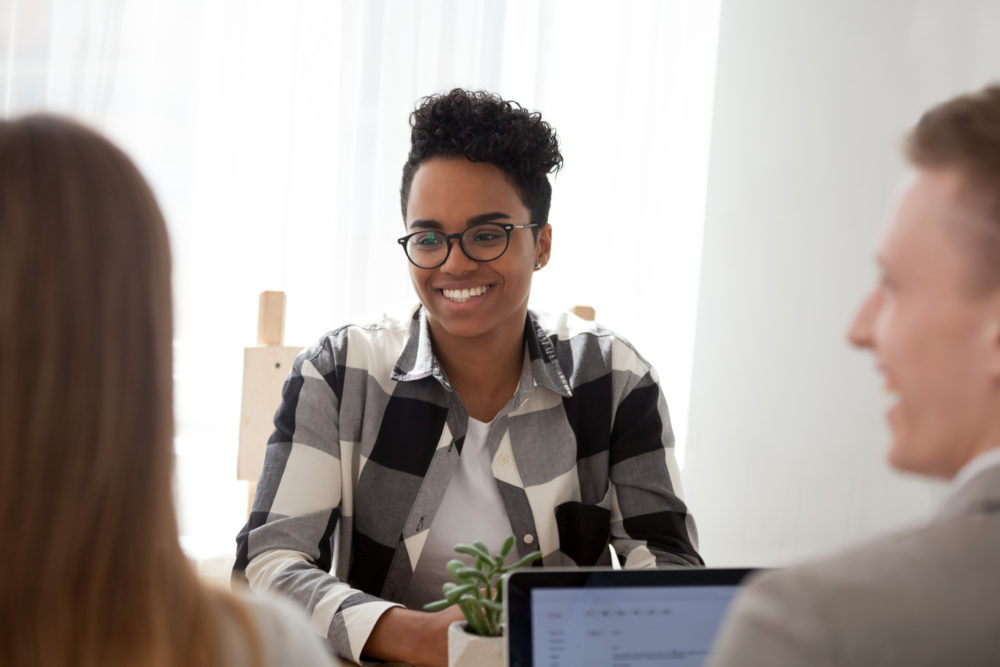 Woman laughs in office