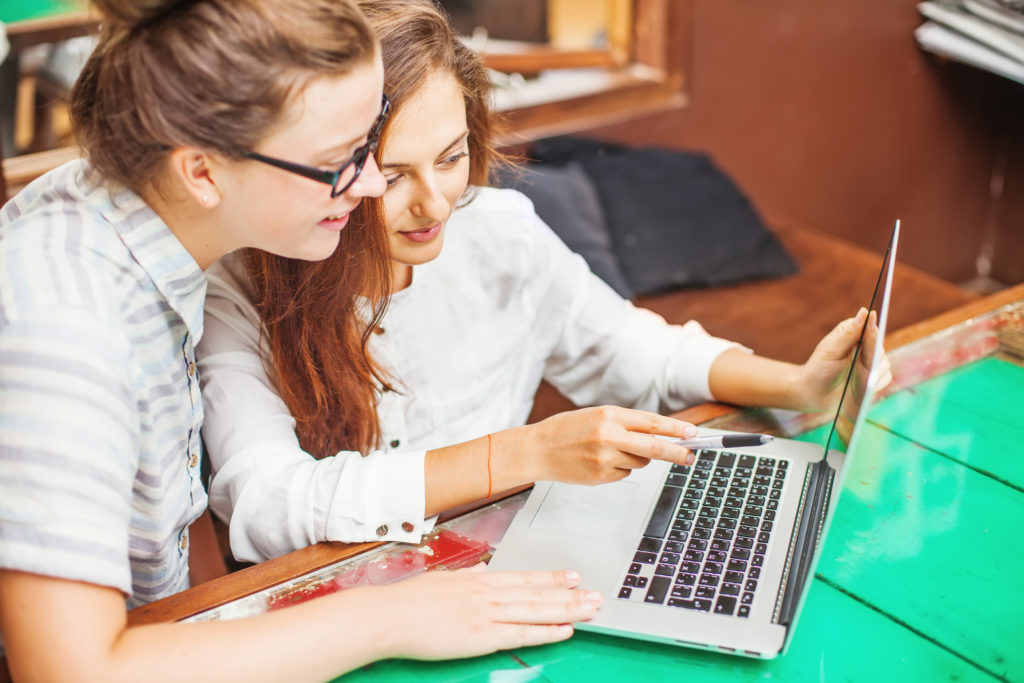 Two students at a computer